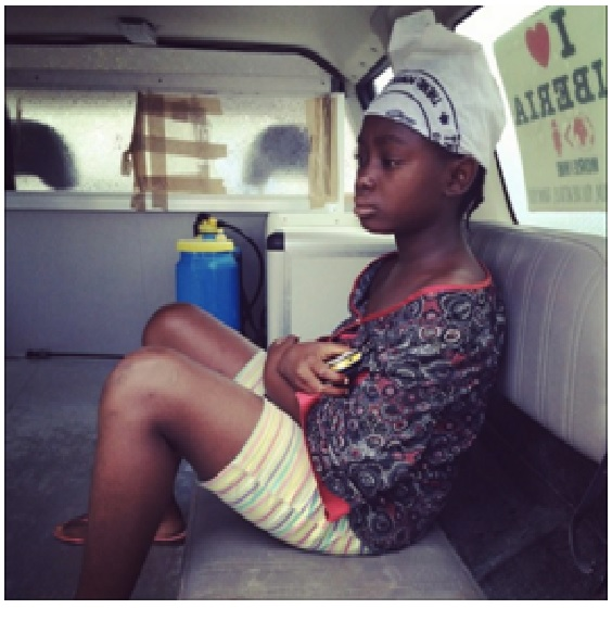 Sarah alone in the ambulance on her way to the Ebola treatment unit