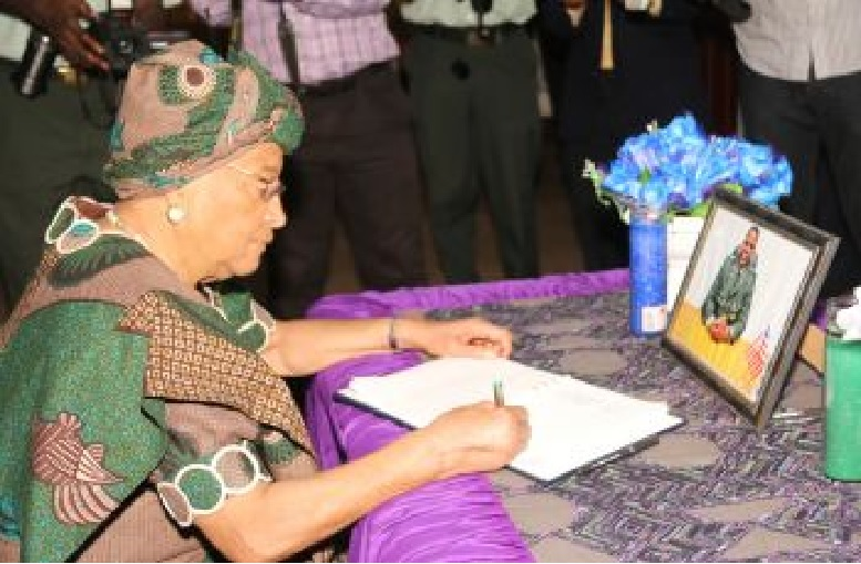 Liberian Leader Signs the book of condolence of AFL Deputy Chief of Staff