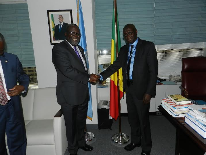 Ambassador Brown in handshake with the Senegalis Ambassador  Fode Seck