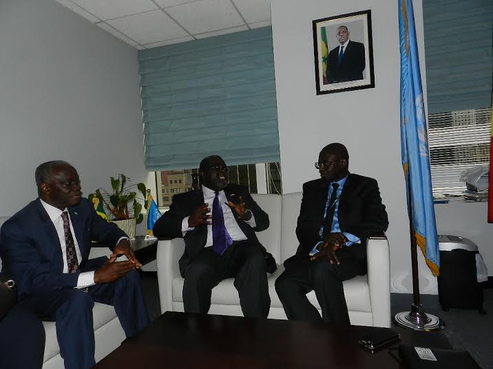 Ambassador Brown in conversation with Ambassador Seck and Tanou respectively