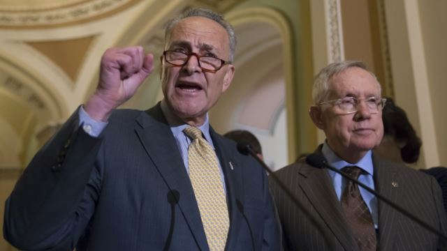 Sen. Charles Schumer, D-N.Y., joined at right by Senate Minority Leader Harry Reid of Nev., criticizes Republican lawmakers for being too tied to the NRA and the gun lobby, during a news conference on Capitol Hill in Washington, Tuesday, June 14, 2016.