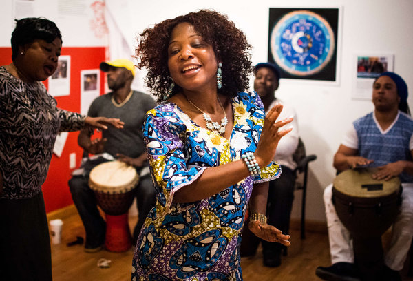 Vocalist Zaye Tete (center) of the Liberian Women's Chorus for Change dances to djembe drummers during rehearsal at the Philadelphia Folklore Project. (AARON WINDHORST / Staff Photographer)